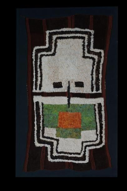 Poncho de seigneur Nazca  Poncho de dignitaire, il présente un masque aux belles...