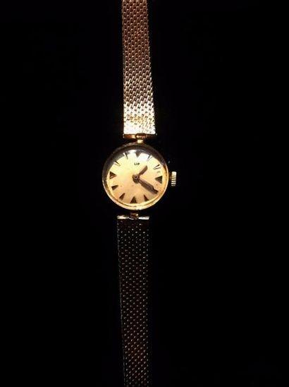 LIP  Montre bracelet de dame en or jaune...