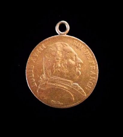 Une pièce en or de 20 FF Louis XVIII  1814...