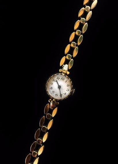 Montre bracelet de dame en or jaune 14 K...