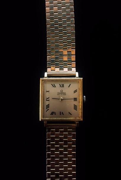 OMEGA  Montre bracelet en or jaune 18 K (750...