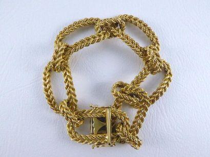Bracelet gourmette en or jaune 18k (750 millièmes)...
