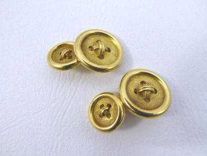 Paire de boutons de manchettes en or jaune 18k (750 millièmes) de forme de boutons...
