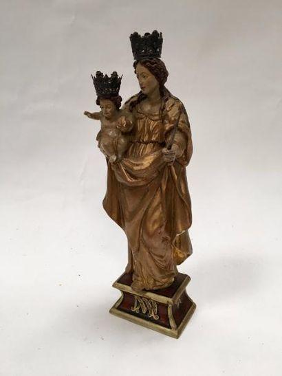 Vierge à l'enfant en bois sculpté polychrone,...