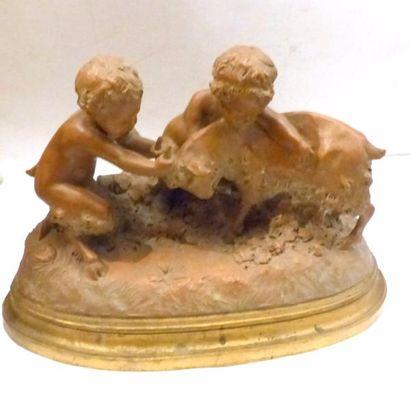 Enfant jouant avec un bouc  Terre cuite  Signé...