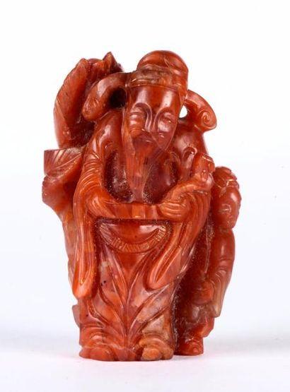 CHINE – Dynastie Qing, Epoque XVIII - XIXe siècle    Sujet en cornaline sculptée...