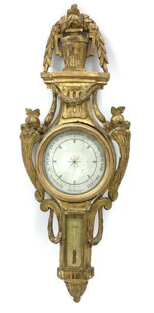 Baromètre-thermomètre en bois doré orné à...