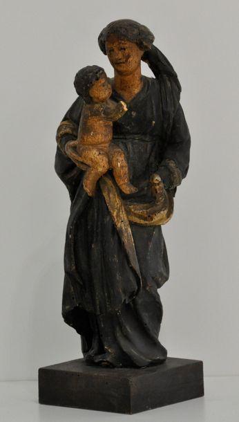 Vierge à l'enfant en bois sculpté  et peint...