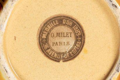 Félix OPTAT MILET (1838 - 1911)  Pichet à anse en faïence émaillée jaune à corps...