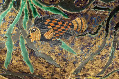 Jean MAYODON, attribué à  Rare bassin en faïence émaillée polychrome à décor d'un...