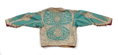 Maroc, début XXe siècle  Gilet d'enfant en feutre turquoise brodé de galons de fils...