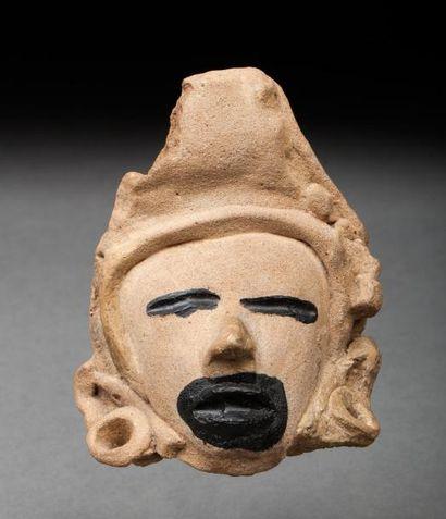 Tête présentant la tête du dieu Quetzalcoatl...