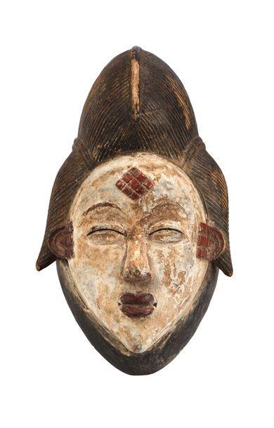 Masque de style Punu en bois polychromé,...