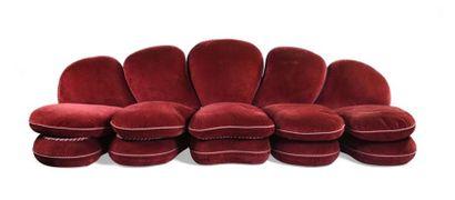 Canapé composé de cinq éléments modulables de tailles et formes différentes recouverts...