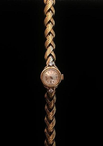 LONGINES  Montre bracelet de dame en or jaune 18 K (750 °/°°), le cadran circulaire...