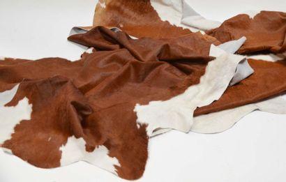 Deux tapis peau de vache