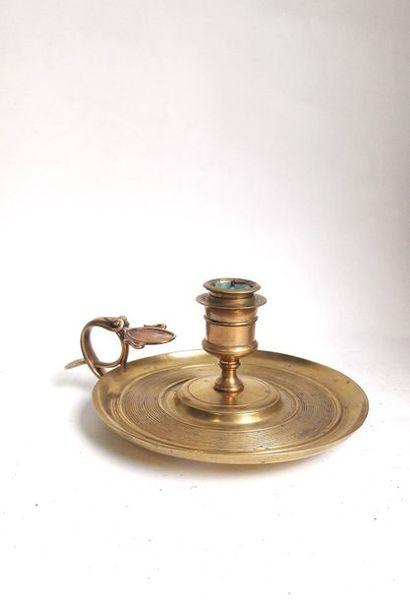 Bougeoir à main en bronze ciselé et doré...