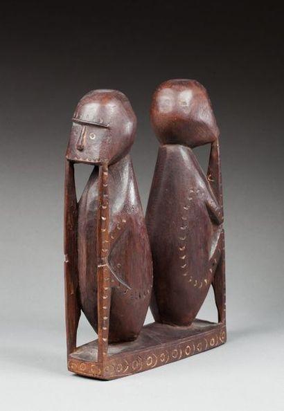 Figure cultuelle présentant deux personnages...