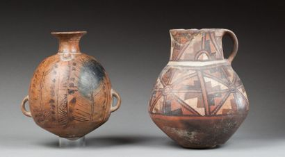 Vase à deux anses agrémenté de symboles végétaux...