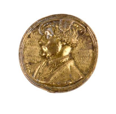 Médaille en argent doré ornée sur l'avers...
