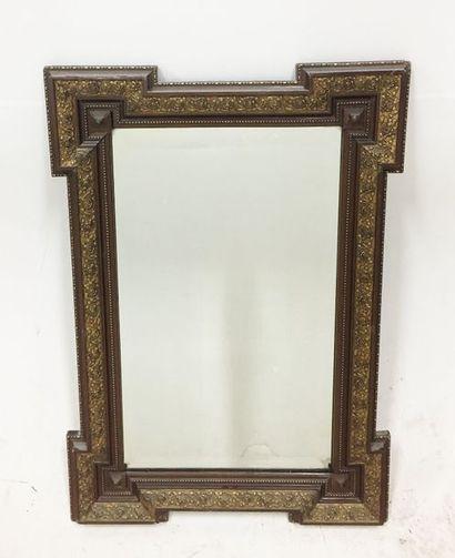 Miroir en bois partiellement doré de style...
