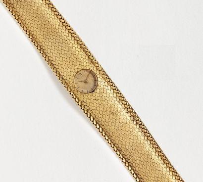 Elegante montre bracelet MELLERIO en or jaune...