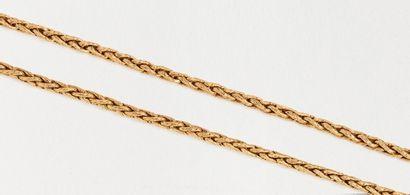 Sautoir maille palmier en or jaune guilloché 18k (750 millièmes). Long. 86 cm environ...