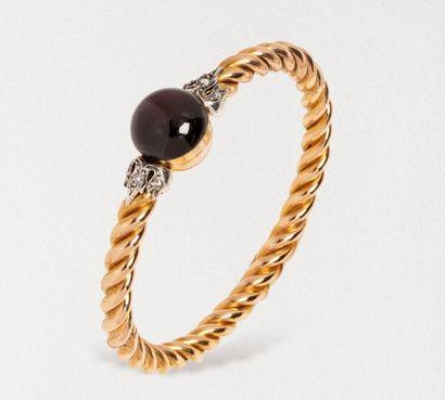 Bracelet rigide en or jaune 18k (750 millièmes)...