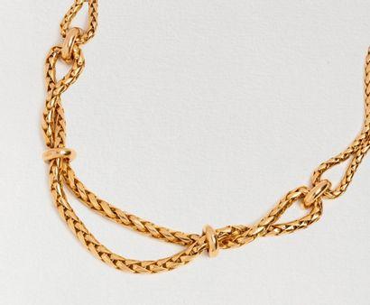 Collier maille palmier à nœuds en or jaune 18k (750 millièmes). Longueur env 41...