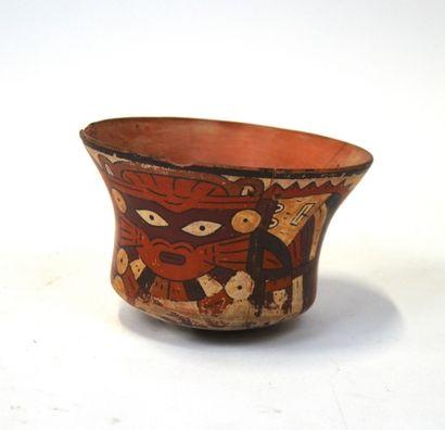Vase à décor stylisé de divinités félines...