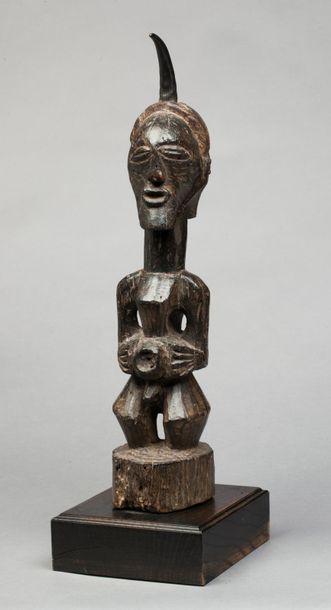 Statue fétiche janus évoquant deux ancêtres...