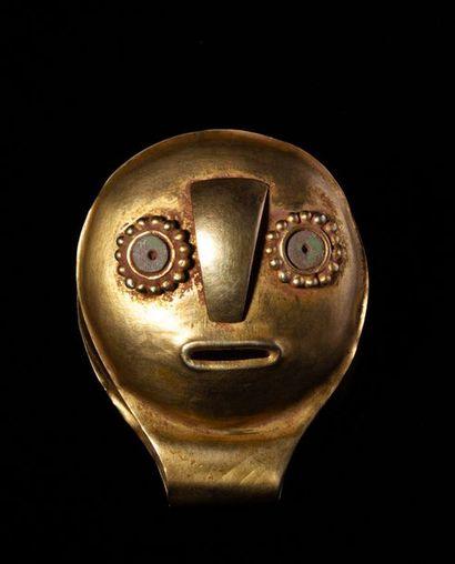 Pince à épiler présentant sur chaque valves un masque stylisé au regard vif et éveillé...