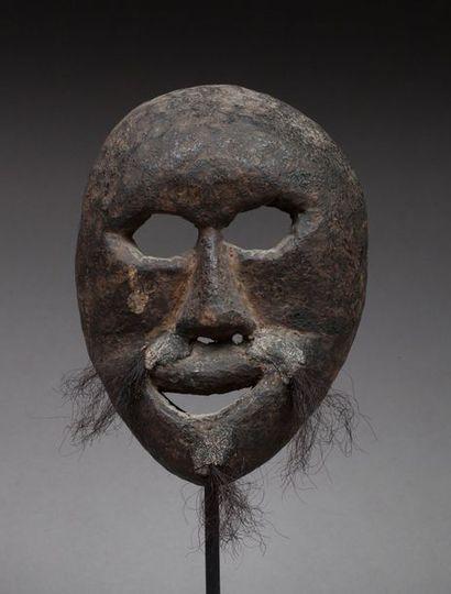 Masque cultuel présentant un visage expressif,...
