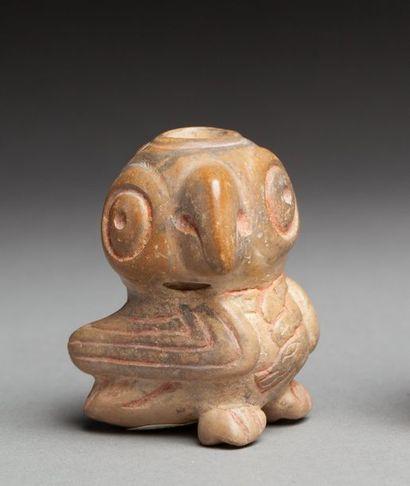 Poporo chamanique sculpté de la figure totémique...
