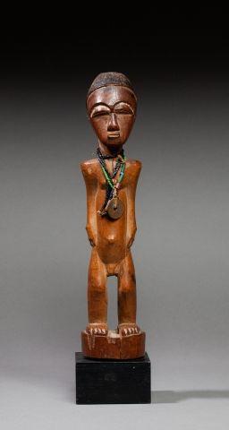 Statuette présentant un personnage masculin...