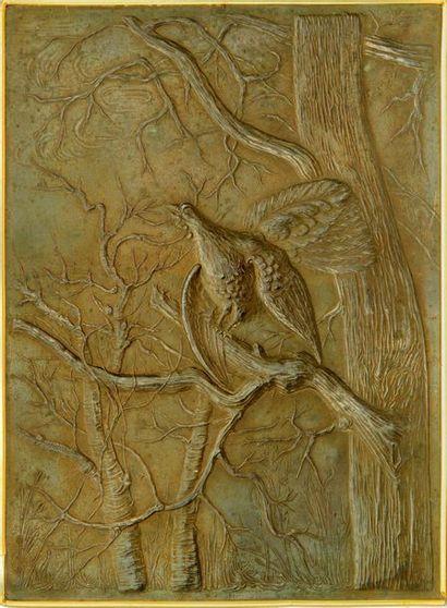 Bas-relief en bronze patiné représentant...