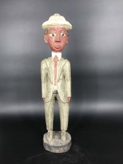 COTE D IVOIRE Côte d Ivoire  Statue de colon représentant un notable en costume de...