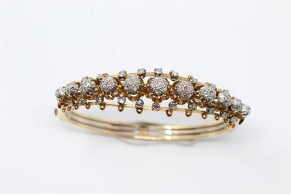 Bracelet rigide ouvrant en or jaune 18K (750),...
