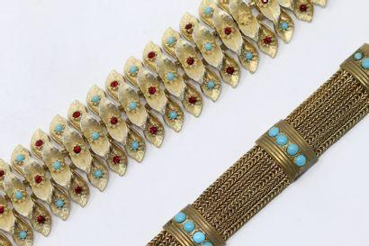 Ensemble de deux bracelets articulés en métal...