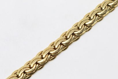 Bracelet en or jaune 18k (750) à maille haricot....