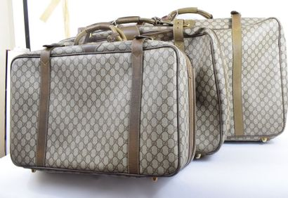 GUCCI  Trois valises en toile