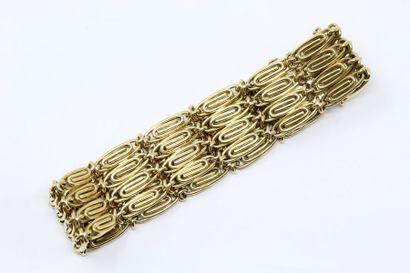 Bracelet en or jaune 18k (750).  Tour de...