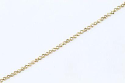 Bracelet ligne en or jaune 18k (750) ornée...