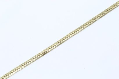 Bracelet en or jaune 18k (750) à maille anglaise....