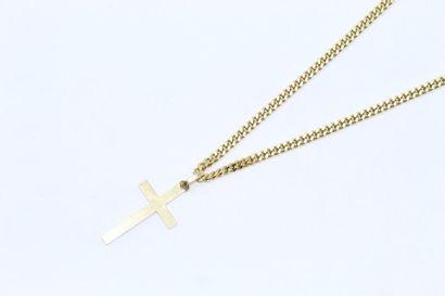Croix et sa chaîne en or jaune 18k (750)...