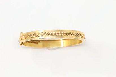 Bracelet rigide en or jaune 18k (750).  Poids...