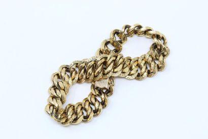 Bracelet en or jaune 18k (750) à maille américaine....