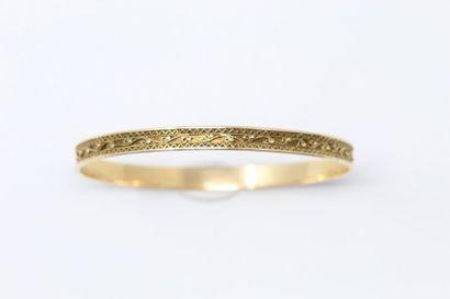 Bracelet rigide en or jaune 18k (750) à décor...