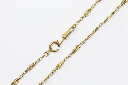 Débris d'or jaune 18k (750) : chaîne giletière....