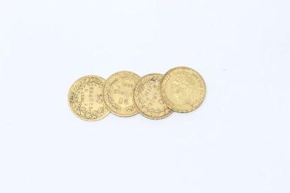 Ensemble de quatre pièces en or de 20 francs...